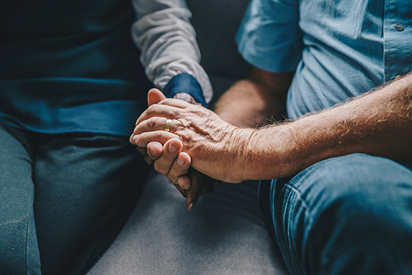 a couple in therapy holding hands